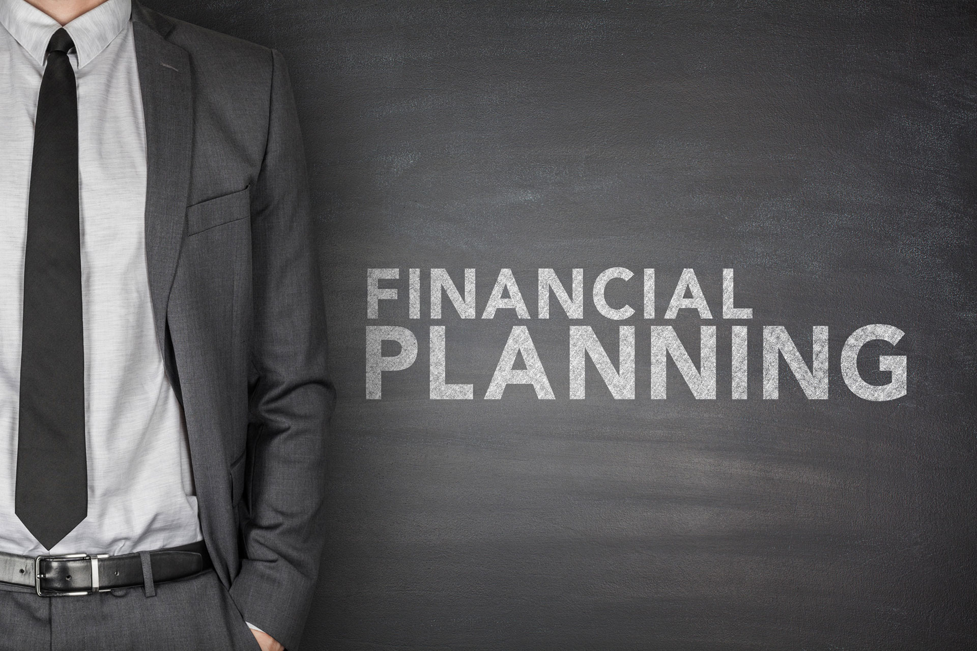 financial-planning-text-on-black-blackboard-m